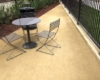 GraniteCrete permeable paving installation with table and chairs at Hanover Cannery Park in San Jose.