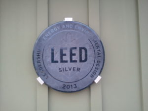 LEED Certification Award on the outside of the MEarth building next to Carmel Middle School.